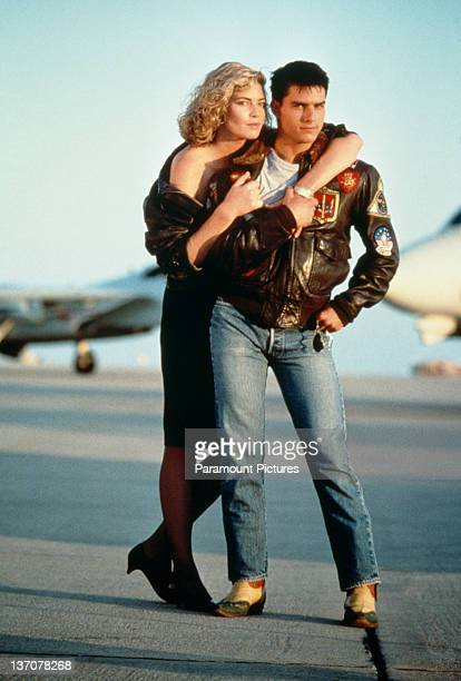 American actors Tom Cruise as Lieutenant Pete 'Maverick' Mitchell and Kelly McGillis as Charlotte 'Charlie' Blackwood in a promotional portrait for...