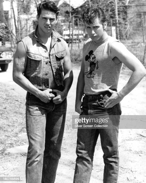 American actors Tom Cruise as Steve Randle and Emilio Estevez as TwoBit Matthews in a publicity still for 'The Outsiders' directed by Francis Ford...