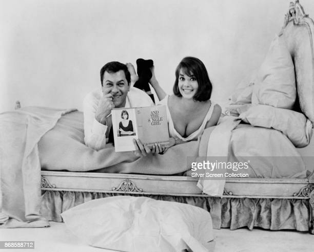 American actors Tony Curtis and Natalie Wood lie on a bed for the film 'Sex and the Single Girl' Los Angeles California 1964