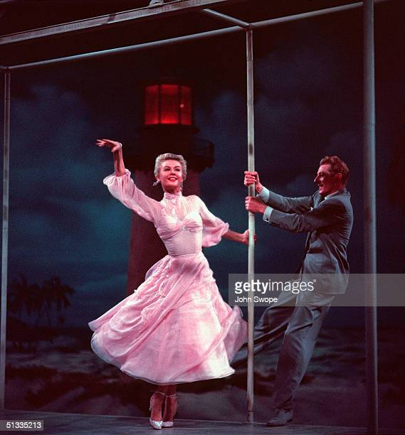 American actors VeraEllen and Danny Kaye dance and sing together during the 'Love You Didn't Do Right By Me' number in a still from the film 'White...