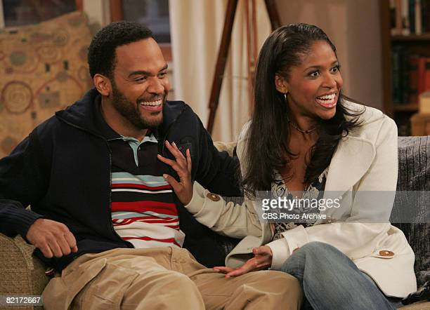 American actors Victor Williams and Merrin Dungey as Deacon and Kelly Palmer smile in a scene from an episode of the television comedy 'The King of...