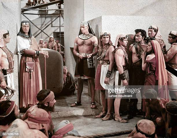 American actors Vincent Price, Charlton Heston, John Derek and Debra Paget on the set of The Ten Commandments, directed by Cecil B. DeMille.