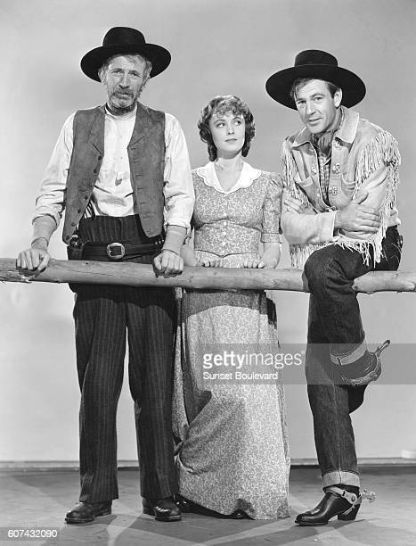 American actors Walter Brennan Doris Davenport and Gary Cooper on the set of The Westerner directed by William Wyler