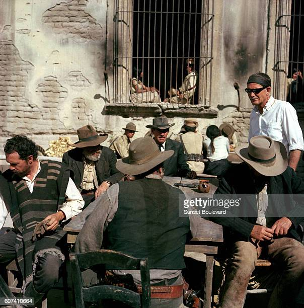 American actors Warren Oates Edmond O'Brien Ernest Borgnine and William Holden with director Sam Peckinpah on the set of his movie The Wild Bunch