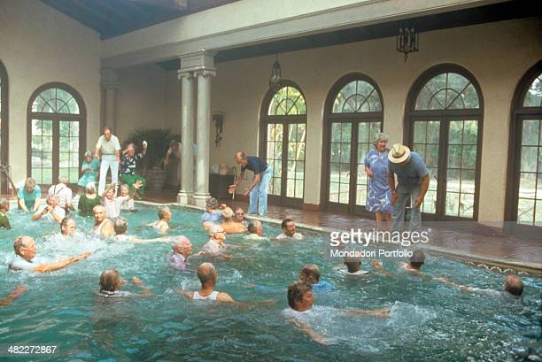 American actors Wilford Brimley Hume Cronyn and Don Ameche at the edge of a swimming pool acting in the film Cocoon 1985