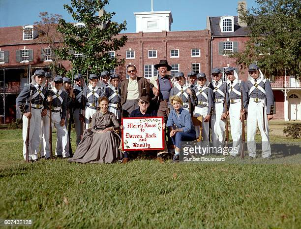 American actors William Holden John Wayne and Contance Towers with director John Ford on the set of his movie The Horse Soldiers