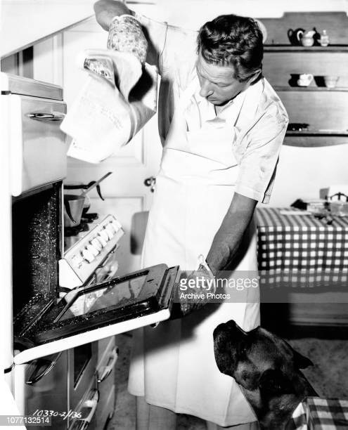 American actorsinger and dancer Danny Kaye cooks a meal at home circa 1950 His speciality is Chinese food