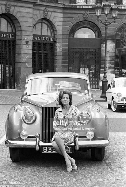American actress Abbe Lane posing with her Rolls Royce Paris 13th August 1962