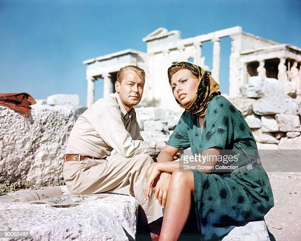 American actress Alan Ladd as Dr Jim Calder and Sophia Loren as Phaedra in the film 'Boy on a Dolphin' 1957 They are posing in front of the...