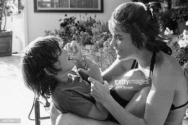 American actress Ali MacGraw at home in Malibu with her son Josh Evans, whom she had with actor and producer Robert Evans.