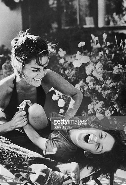 American actress Ali MacGraw tickles her son Josh Evans California 1978