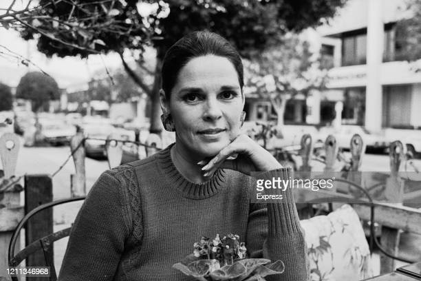 American actress Ali MacGraw, wearing a knitted jumper, as she supports her chin on her hand, 6th February 1985.