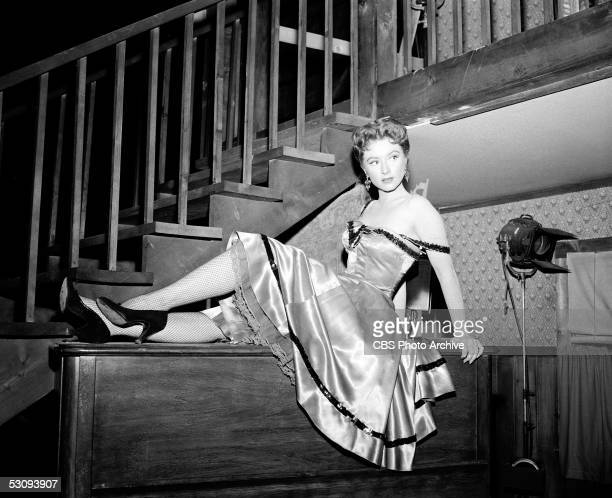 American actress Amanda Blake reclines next to lighting equipment for the taping of the episode 'Kite's Reward' of the TV western 'Gunsmoke' August 3...