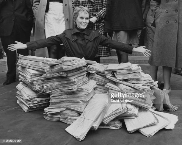 American actress and activist Mia Farrow with her arms outstretched before a petition with 425,418 signatures, organised by the Society for the...