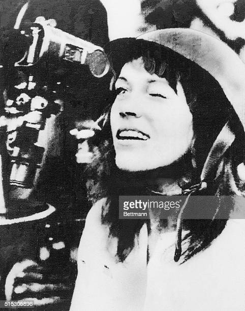 American actress and antiwar activist Jane Fonda looks though the scope of an antiaircraft gun during her tour of the North Vietnamese capital She...