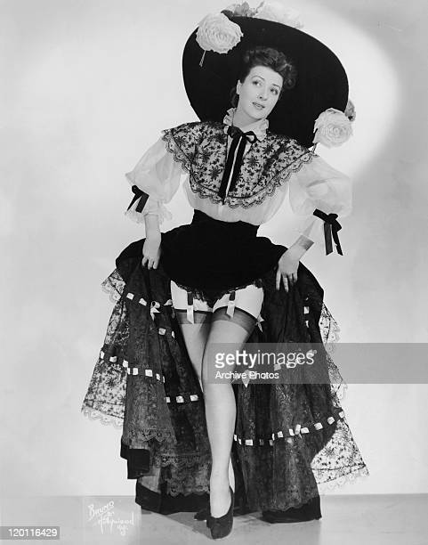 American actress and burlesque entertainer Gypsy Rose Lee in a widebrimmed hat lace skirt and top with matching trim circa 1945