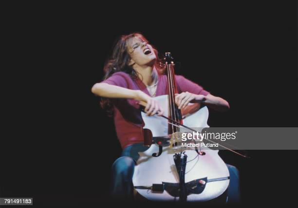 American actress and cellist Lori Singer performs on stage with the cast of the television series Fame at Wembley Arena in London in April 1983