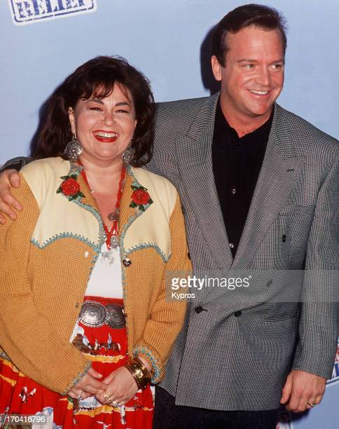 American actress and comedia Roseanne Barr with her husband actor Tom Arnold circa 1990