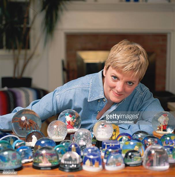 American actress and comedian Alison Arngrim with a collection of snowglobes circa 1996