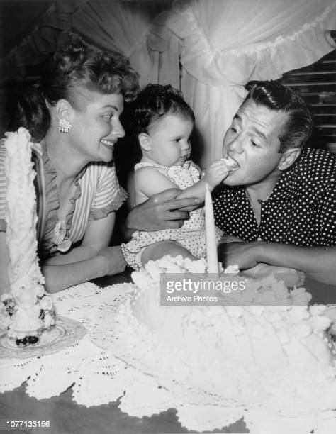 American actress and comedian Lucille Ball and her husband Desi Arnaz celebrate the 1st birthday of their daughter Lucie Arnaz at their home in North...