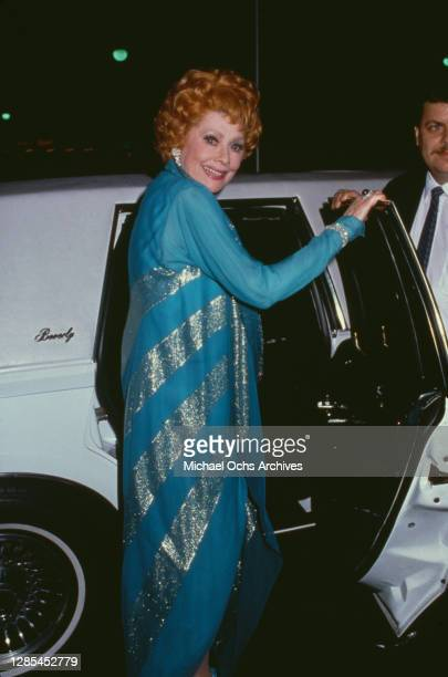American actress and comedian Lucille Ball turns to smile as she opens a car door after attending a tribute to Lucille Ball, held at the Museum of...