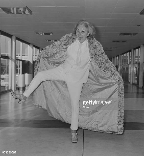 American actress and comedian Phyllis Diller arrives at Heathrow airport in London on 7th December 1970