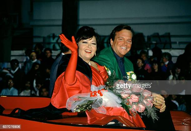 American actress and comedian Roseanne Barr and husband American actor and comedian Tom Arnold wave to people during the 61st Annual Hollywood...