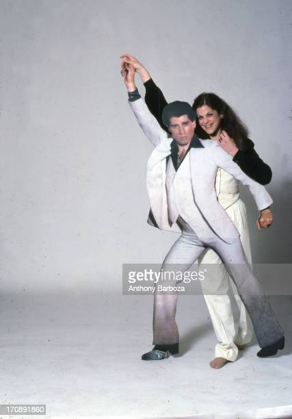 American actress and comedienne Gilda Radner poses with a cardboard cutout of actor John Travolta in a pose from the film 'Saturday Night Fever' New...