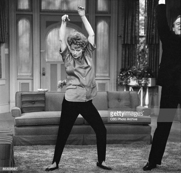 American actress and comedienne Lucille Ball as Lucille Carmichael practices dance moves with Hans Conried as Dr Gitterman in a scene from an episode...