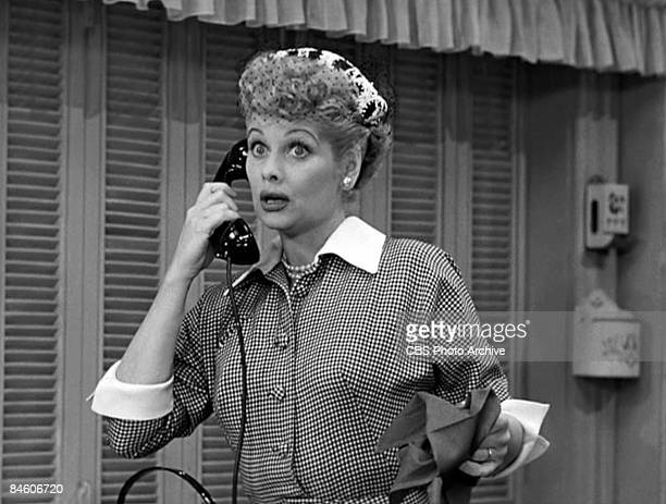 American actress and comedienne Lucille Ball as Lucy Ricardo talks on the telephone in a scene from an episode of the television comedy 'I Love Lucy'...