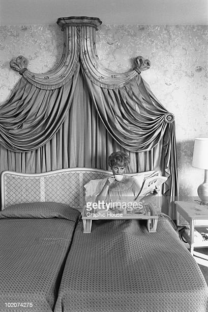 American actress and comedienne Lucille Ball has breakfast in bed at the Hilton Hotel circa 1955