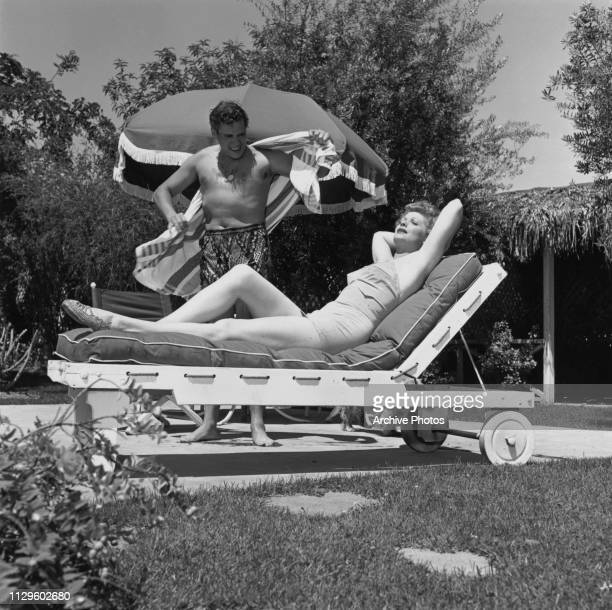 American actress and comedienne Lucille Ball with her husband, Cuban-born American actor and musician Desi Arnaz in the garden at their home, circa...