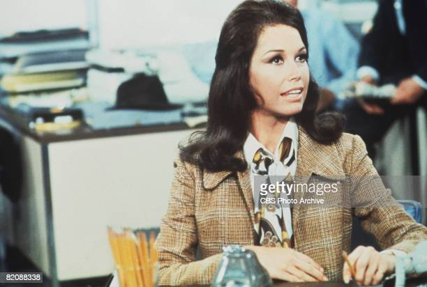 American actress and commediene Mary Tyler Moore sits at a desk in a scene from 'The Mary Tyler Moore Show' , Los Angeles, California, 1970.