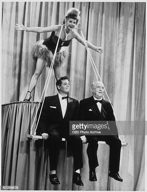 American actress and commedienne Lucille Ball appears to suspend from left her husband Cuban actor and musician Desi Arnaz and American actor William...