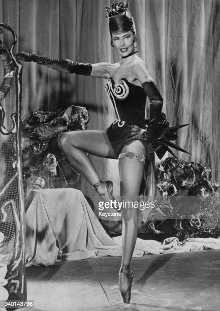 American actress and dancer Cyd Charisse appears in 'Deuil en 24 Heures' one of four segments of the film 'Black Tights' directed by Terence Young...