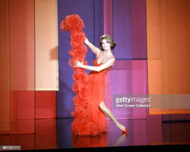 American actress and dancer Cyd Charisse as Sarita in the opening sequence of the spy spoof 'The Silencers' 1966