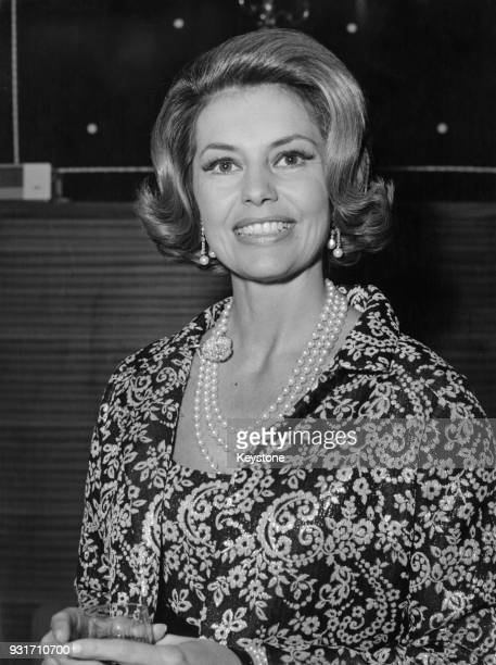 American actress and dancer Cyd Charisse attends a cocktail party thrown by the studio for the cast of the film 'Assassination in Rome' April 1963