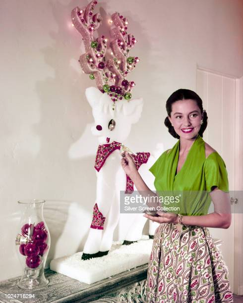 American actress and dancer Cyd Charisse decorates for Christmas circa 1955