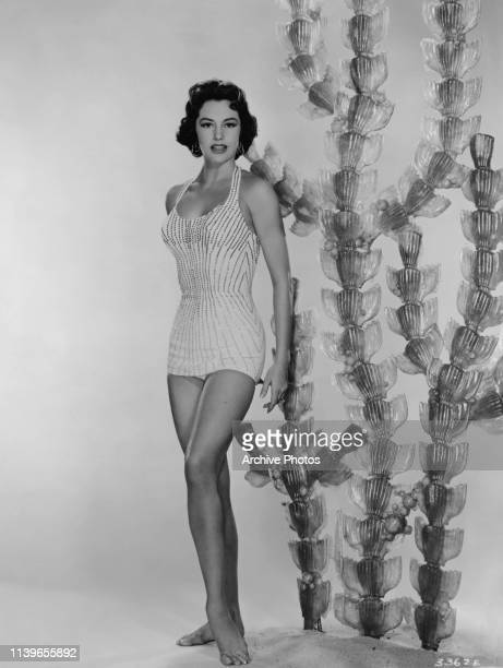 American actress and dancer Cyd Charisse wearing a onepiece sequinned swimsuit circa 1950