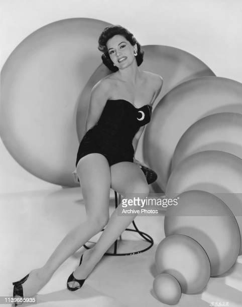 American actress and dancer Cyd Charisse wearing a onepiece swimsuit circa 1950