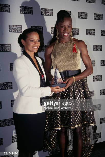 American actress and dancer Debbie Allen and American heptathlete Jackie Joyner-Kersee attends the 1993 Jim Thorpe Sports Awards, held at the Wiltern...