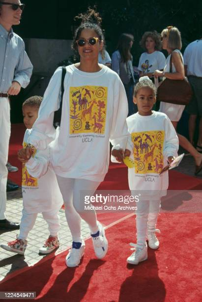 American actress and dancer Debbie Allen holds the hands of two of her children, Norman Nixon Jr and Vivian Nixon, with all three wearing matching...