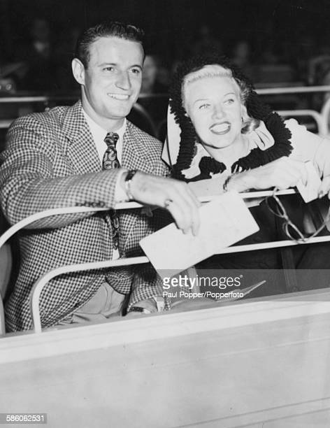 American actress and dancer Ginger Rogers and her husband Jack Briggs pictured together at the Hollywood Park Turf Club California November 2nd 1945