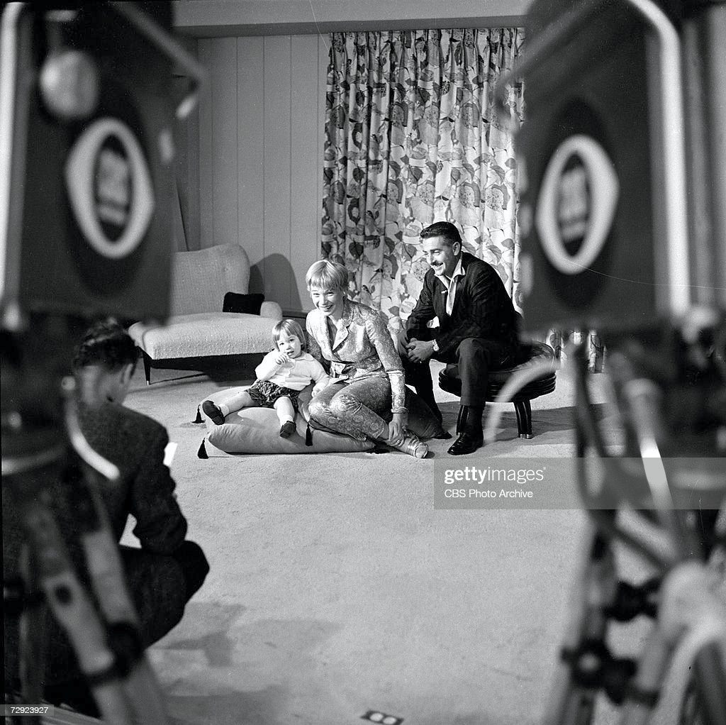 American actress and entertainer Shirley MacLaine poses with her husband, Steve Parker, and their daughter, Sachi Parker, in their home on an episode of the CBS celebrity interview program 'Person to Person,' March 6, 1959.