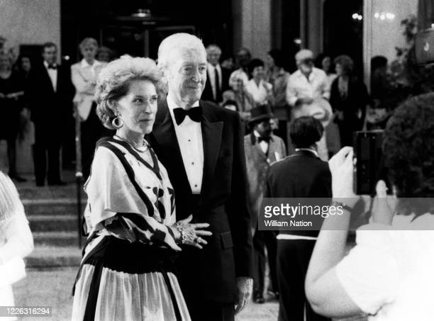 American actress and model Gloria Hatrick McLean and husband American actor and military officer Jimmy Stewart arrive at the Women's Wear Daily party...