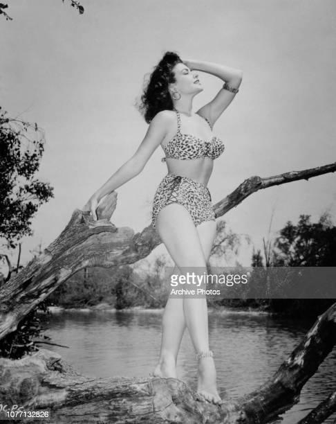 American actress and model Mara Corday wearing a leopard print bikini 1954