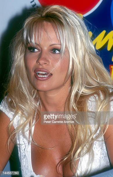 American actress and model Pamela Anderson who appears in the television show 'Baywatch' attends a press conference to promote the Coca Cola Surf...
