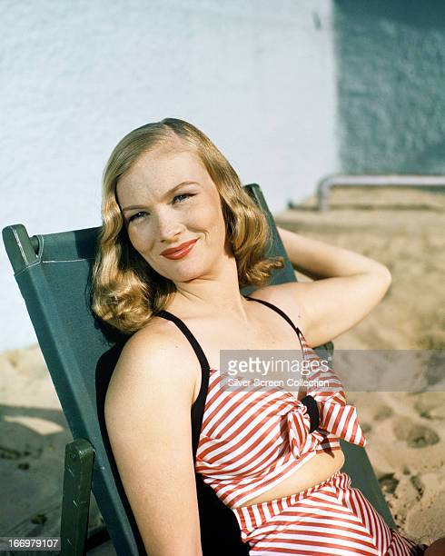 American actress and model Veronica Lake in a red and white striped beach outfit circa 1945
