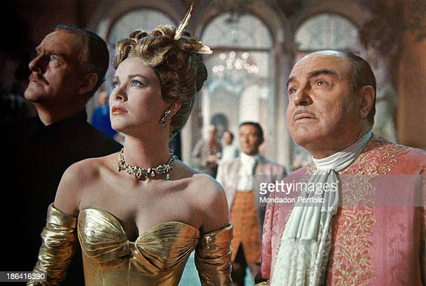 American actress and Princess consort of Monaco Grace Kelly British actor John Williams and French actor René Blancard looking up worried in the film...