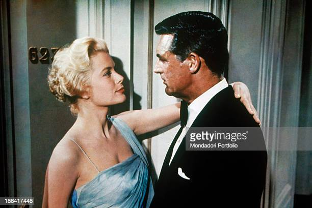 American actress and Princess consort of Monaco Grace Kelly hugging American actor Cary Grant in the film To Catch a Thief USA 1955